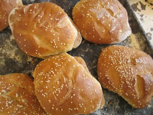 Cocoles (glazed buns with syrup, topped with sesame seeds)